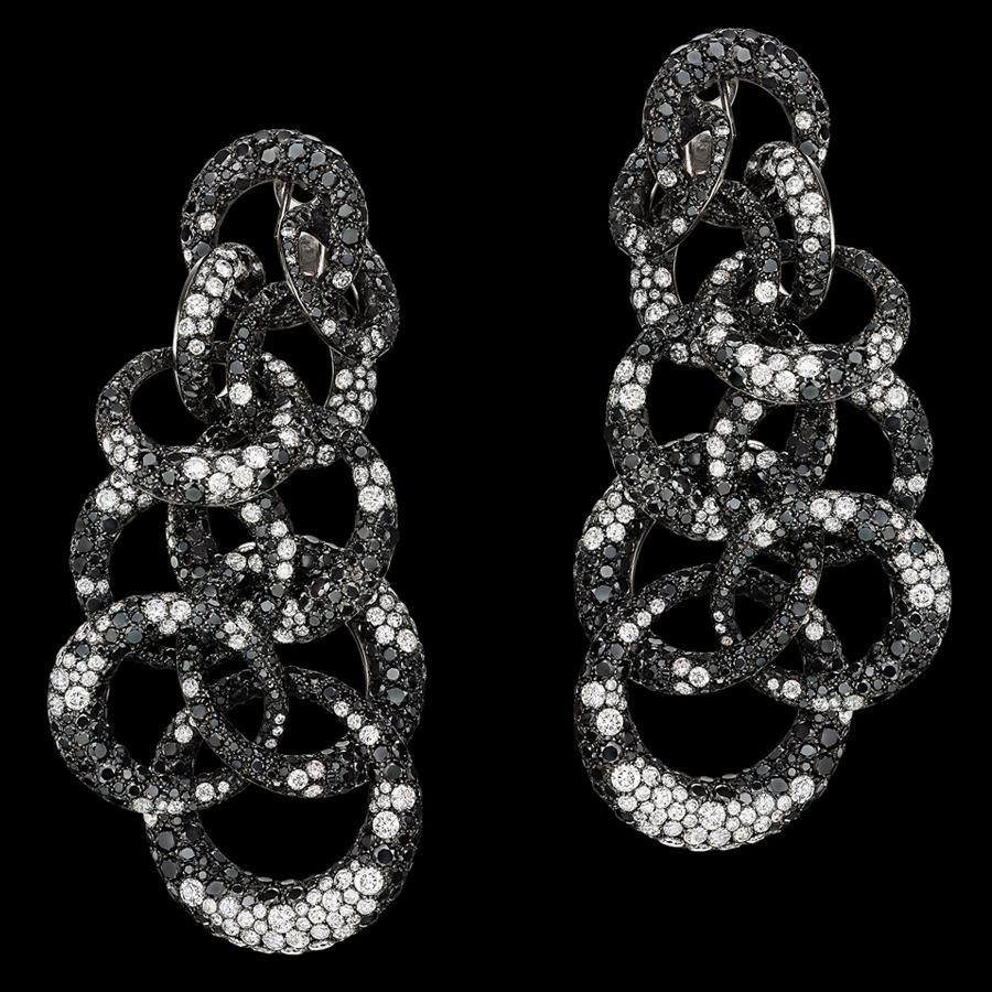 9 Kolczyki zbiałymi iczarnymi diamentami zkolekcji Anelli