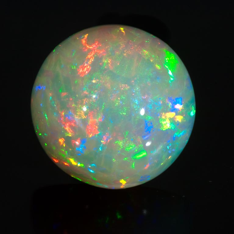 Round cabochon white opal from Ethiopia.