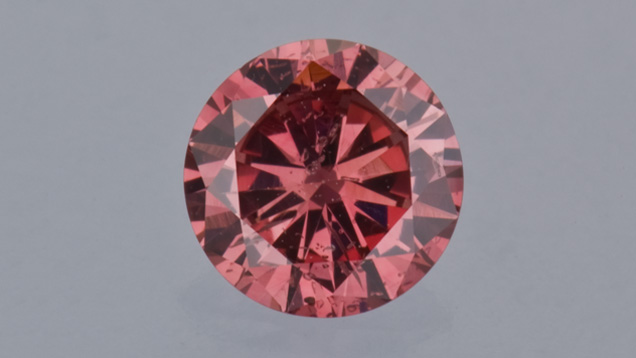 0.51 ct round cut reddish-pink diamond from the Aurora Butterfly of Peace.